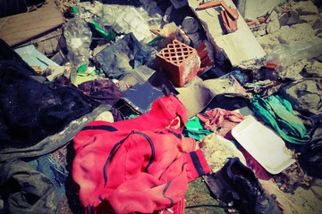 red sweatshirt in the middle of rubbish heaps with vintage effec