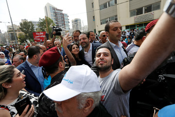 People take selfies with Lebanese prime minister and candidate for the parliamentary election Saad al-Hariri after he cast his vote in Beirut