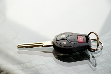 Car remote control placed on glass background