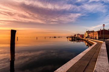 Romantic sunset on the Venice lagoon. Island of Pellestrina.