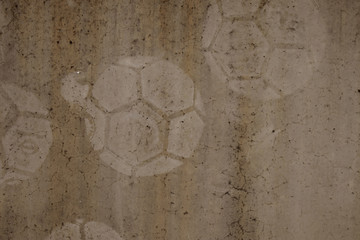 football print on cement background,soccer slough on wall