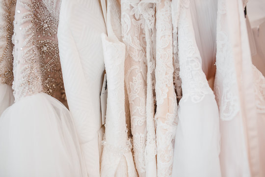 White modern wedding dresses in gown store.