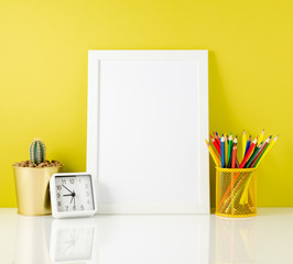 Mockup with clean white frame, colored pencils on the bright yellow background. Concept for creativity, drawing.