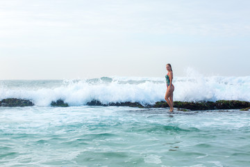 girl standing on a reef