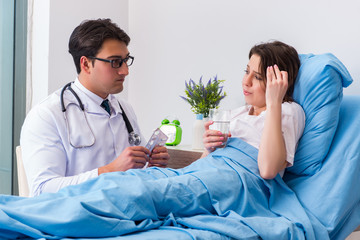 Doctor visiting patient in hospital room