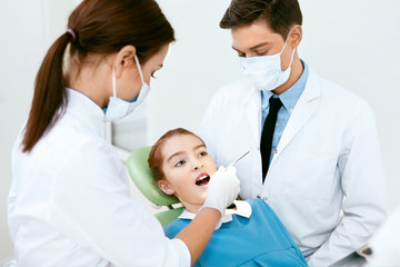Oral Health Care. Dentist Doctors Making Examination Procedure
