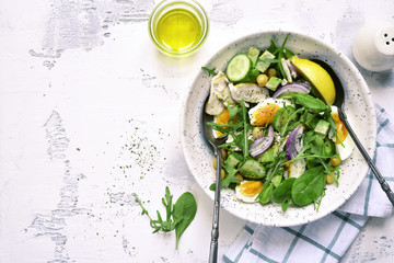 Green vegetable salad with chickpea,chicken fillet and boiled eggs.Top view with copy space.