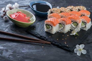 Philadelphia rolls  with salmon,  avocado, eel on stone black background.  Sushi rolls, japanese food.