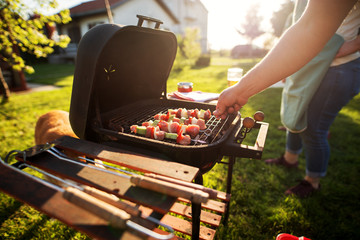 Beautiful fresh and juicy vegetables on a stick are being grilled on an old vintage grill during a beautiful sunny day.