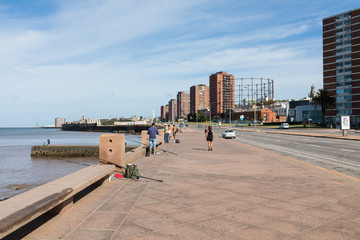 People fishing at boulevard in Montevideo, Uruguay. Montevideo is the capital and the largest city of Uruguay