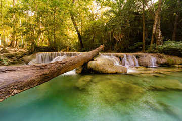 Tropical stream waterfall in deep forest jungle, natural landscape background