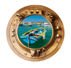 brass porthole and sunlit maltese rowing boat