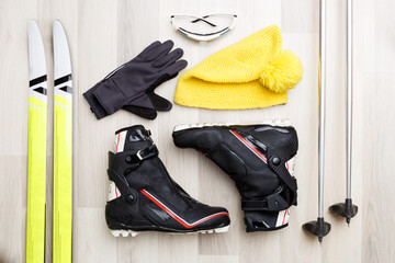Picture of skier accessories on wooden background.