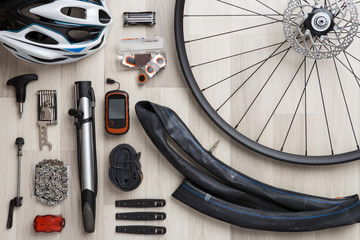 Picture of bicycle objects on wooden background.