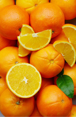 A lot of An orange, whole and split. Sweet orange is the fruit of the citrus.