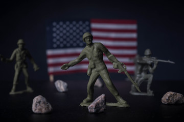 Toy soldiers in front of an American flag
