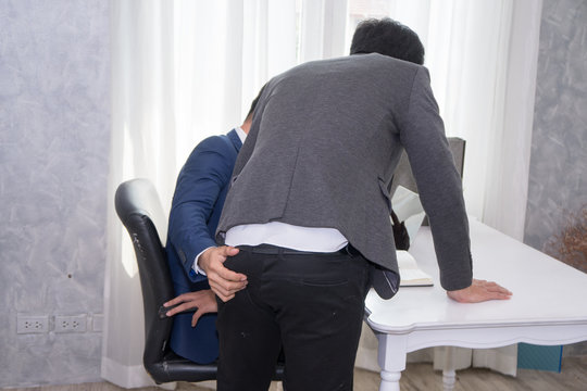 Manager man molesting male employee in workplace. Sexual harassment at workplace