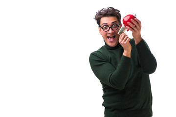 Nerd young man with piggybank isolated on white