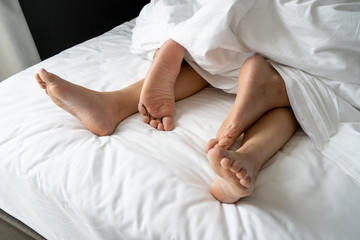 Foot man and girl be tired on the bed, couple bed story