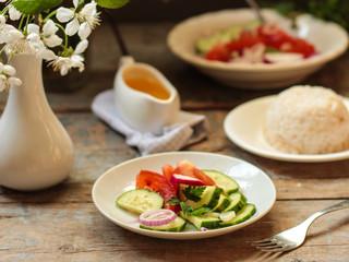 Vegetable salad from organic vegetables - healthy food (fresh vegetable set).  Food background