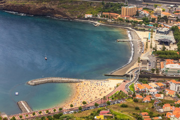 View of Machico beach from the viewpoint of Pico do Facho on a summer day, in Madeira island, Portugal.