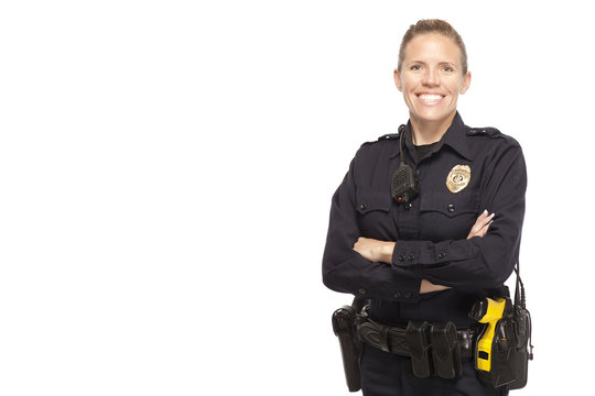 Female police officer posing with arms crossed