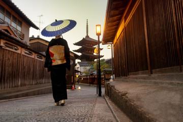 Asian woman with kimono walking at Yasaka Pagoda in Kyoto Wall mural
