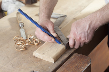 carpenter drawing on a wooden board.copy space