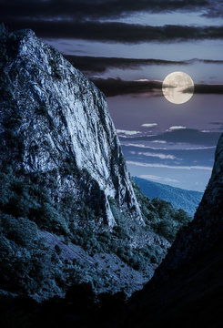 cliffs of Trascau mountains canyon at night in full moon light. lovely scenery of Carpathian landscape in springtime. beautiful travel destination. location Cheile Valisoarei, Romania