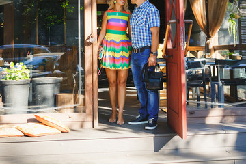 beautiful girl and man leave cafe at summer