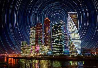 Moscow International Business Center at night with bright stars trails. Moscow, Russia.  Elements of this image furnished by NASA.