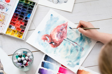 art therapy. painting classes or courses. creativity inspiration expression concept. watercolor inks palette and brushes. picture of flamingo