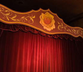 Stage with red curtains and a yellow rose. stage for shows