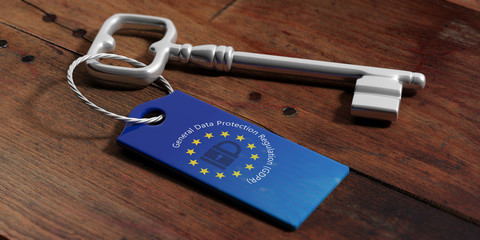GDPR and European Union flag on a key tag, wooden background. 3d illustration
