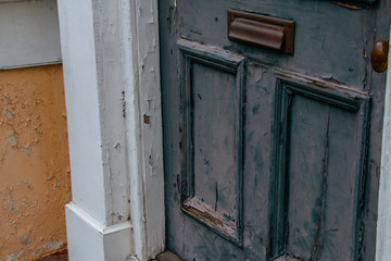 Exterior door with chipped paint