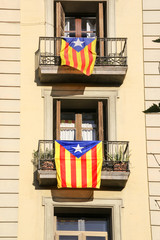 Catalonia flags for Independence hanging on balconies in Barcelona, , Spain.