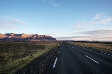 Road in Iceland in sunrise light, autumn
