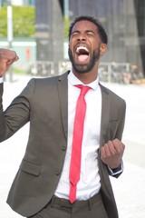 Beautiful happy businessman outside
