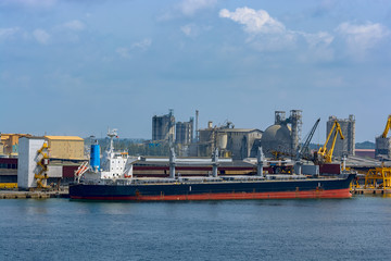 Bulk carrier vessel in port.