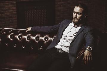 casanova on leather sofa