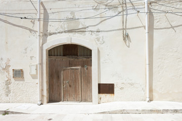 Vieste, Apulia - A folding gate, two rainwater pipes and some cables
