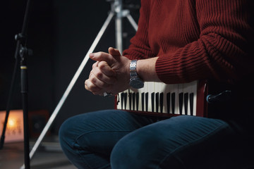 Melodica in hands of man, wind instrument, recording of music in the studio