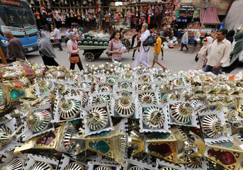 """Traditional Ramadan lanterns called """"fanous"""" are displayed for sale at a stall, ahead of the Muslim holy month of Ramadan in Cairo"""