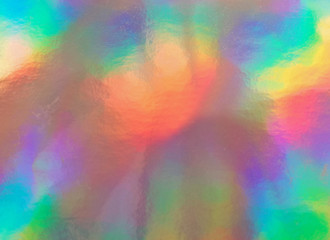 Holographic paper, rainbow silver textured background.
