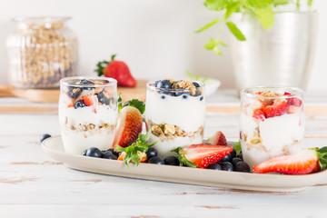 Little Jars with layered dessert from natural yogurt, granola an