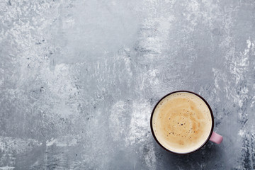 Cup of coffee on grey wooden table