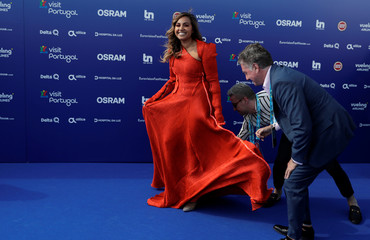 Contestant Jessica Mauboy of Australia poses on the blue carpet during the opening party for Eurovision Song Contest at the Maat museum in Lisbon