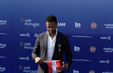 Contestant Cesar Sampson of Austria poses on the blue carpet during the opening party for Eurovision Song Contest at the Maat museum in Lisbon