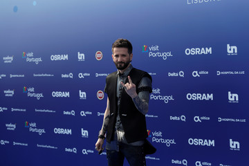 Contestant Eugent Bushpepa of Albania poses on the blue carpet during the opening party for Eurovision Song Contest at the Maat museum in Lisbon