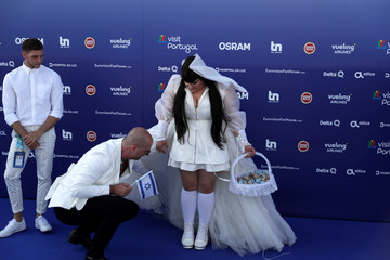 Contestant Netta of Israel is prepared to pose on the blue carpet during the opening party for Eurovision Song Contest at the Maat museum in Lisbon